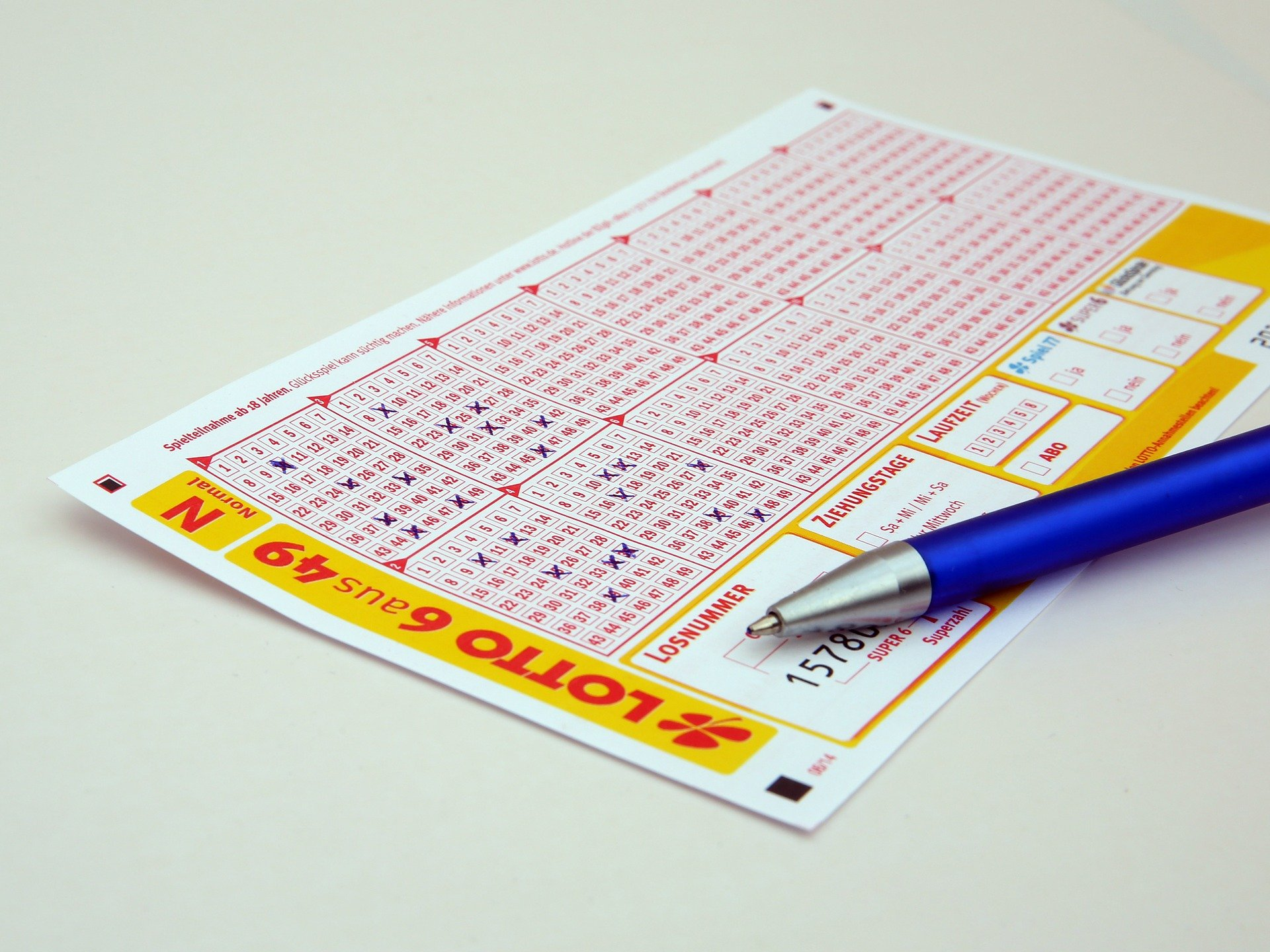 lottery ticket and pan on a table